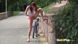 Public Peeing - Redhead babe Kattie pisses on a path