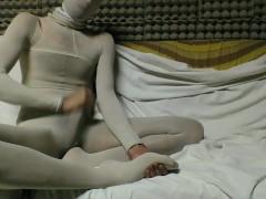 YOUNG GUY IN WHITE PANTYHOSE ENCASEMENT MASTURBATING