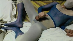 YOUNG GUY IN BLUE AND WHITE PANTYHOSE ENCASEMENT MASTUBATING