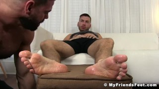 Tattooed jock toe sucked by a hunk while jacking his fat rod Hairy style