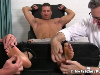 Restrained jock tickled and played with by his horny friends