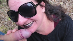 Outdoors On Her Knees Sucking Dick - Facial