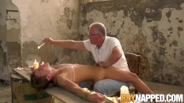 Restrained twink tormented before a sloppy handjob