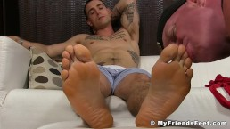 Handsome inked jock toe sucked passionately by his buddy