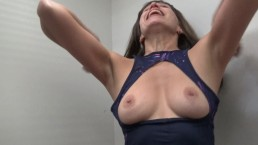 Brunette Cindy masturbates in the fitting room of a sports shop