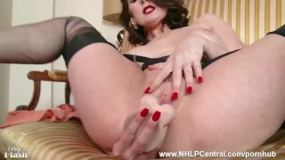 Milf Karina Currie strips off retro lingerie and toys pussy in nylons heels Eating big
