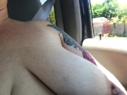 Chastity takes a Sunday drive topless