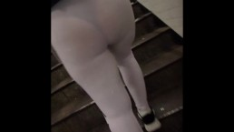 Candid see through white leggings walking through train station