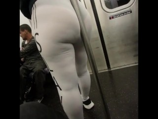 Big Booty Latina see through white leggings on train leaning on pole