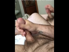 Two hairy dicks jerk off together