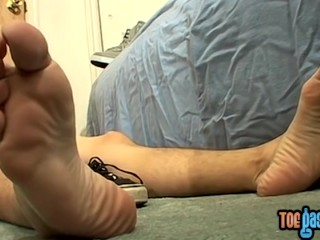 Young man Bentley tugging and jizzing on his pretty feet