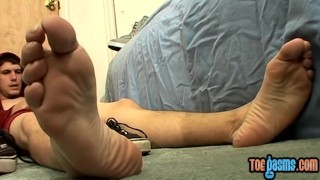 Pretty and young man tugging feet his bentley on jizzing jerking toes