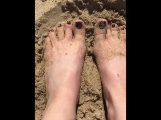 Feet playing with sand