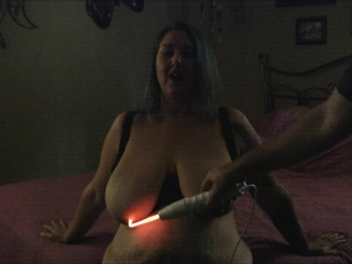 Chastity takes the violet wand to her tits and nipples