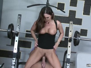 Busty brunette rides a fat dick in the gym