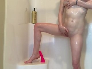 Preview 6 of Teen rides pink dildo in shower