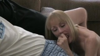 Mature blonde amateur takes on two cocks