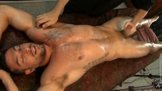 Robbie Caruso pulls his legs back, exposing his tight hole.
