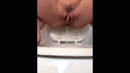 Emma Pisses on the Toilet