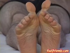 Sexy businessman showing off his perfect toes