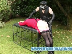 Redhead TGirl slut handcuffed spanked whipped in garden by leather clad guy