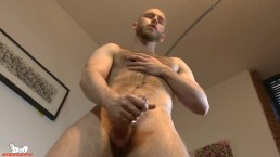 Orson spits on his cock and begins stroking it slowly