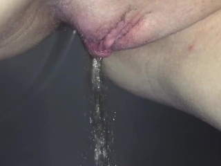 Close up peeing couple