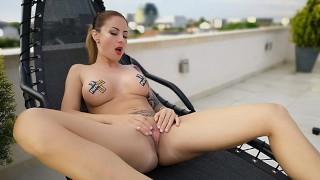 Tattooed slutty milf with big tits masturbating outdoor