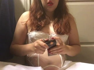 Sexy Chubby Redhead Teen Smoking Goddess wearing White Lingerie Corset