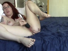 Masturbating Redhead Fingers her ass to a shivering orgasm