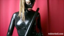 Full black rubber mistress teasing with truncheon