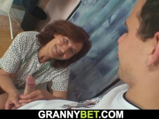 Sewing granny swallows customer's cock
