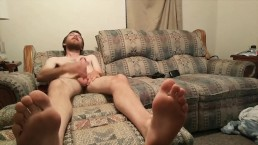 Cute guy jerks off with feet view