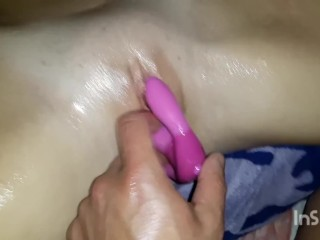 young amateur couple play with toy and oil