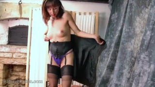 free milf strips off leather outfit to reveal thong nylons corset high heels
