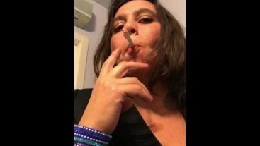 Italian Mistress smoking inhale
