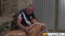 Young roped up twink oiled for handjob by Master
