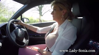 Mature blonde Lady Sonia plays with her tits while driving Secretary wife