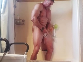 Mature stud takes a shower and cleans his dirty cock
