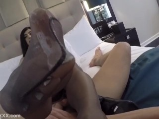 Alina is giving the hottest Shemale nylon footjob