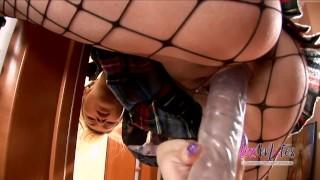 Masturbating blonde in fishnets enjoys her enormous dildo