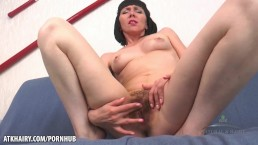 Cherry Despina fingers her hairy cunt