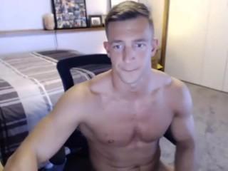 Handsome stud jerks off on cam