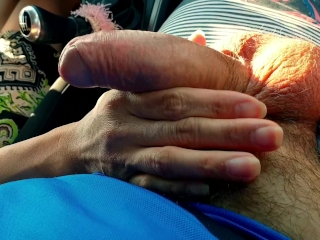 Sweet petite gives nice handjob in rented car