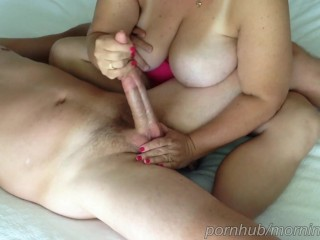 Wife teases my cock and balls during cock massage until I cum.