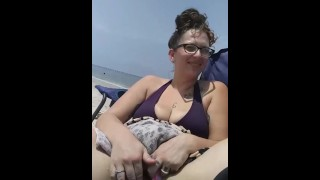 Slut gets super wet touching her hairy pussy at the public beach Huge dick