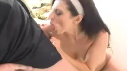 Busty brunette sucks outdoors cock by the pool