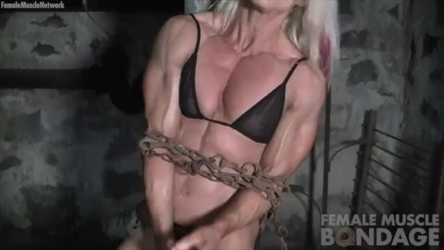 Muscle strain from masturbation Ripped female bodybuilder in chains straining her muscles