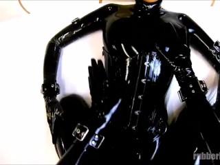 Rubberdoll in full black latex enclosure gets sprayed her mouth with cum...