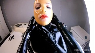 Rubberdoll in full black latex enclosure gets sprayed her mouth with cum...  latex rubber fetish latex doll rubber catsuit cumshot fetish kink rubber rough latex latex fetish rubber doll cum in mouth rubber and latex latex sex latex bondage latex catsuit